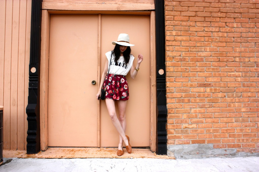 Can't go wrong with a round flower skirt and a tucked in tee. The floppy hat is the cherry on top.