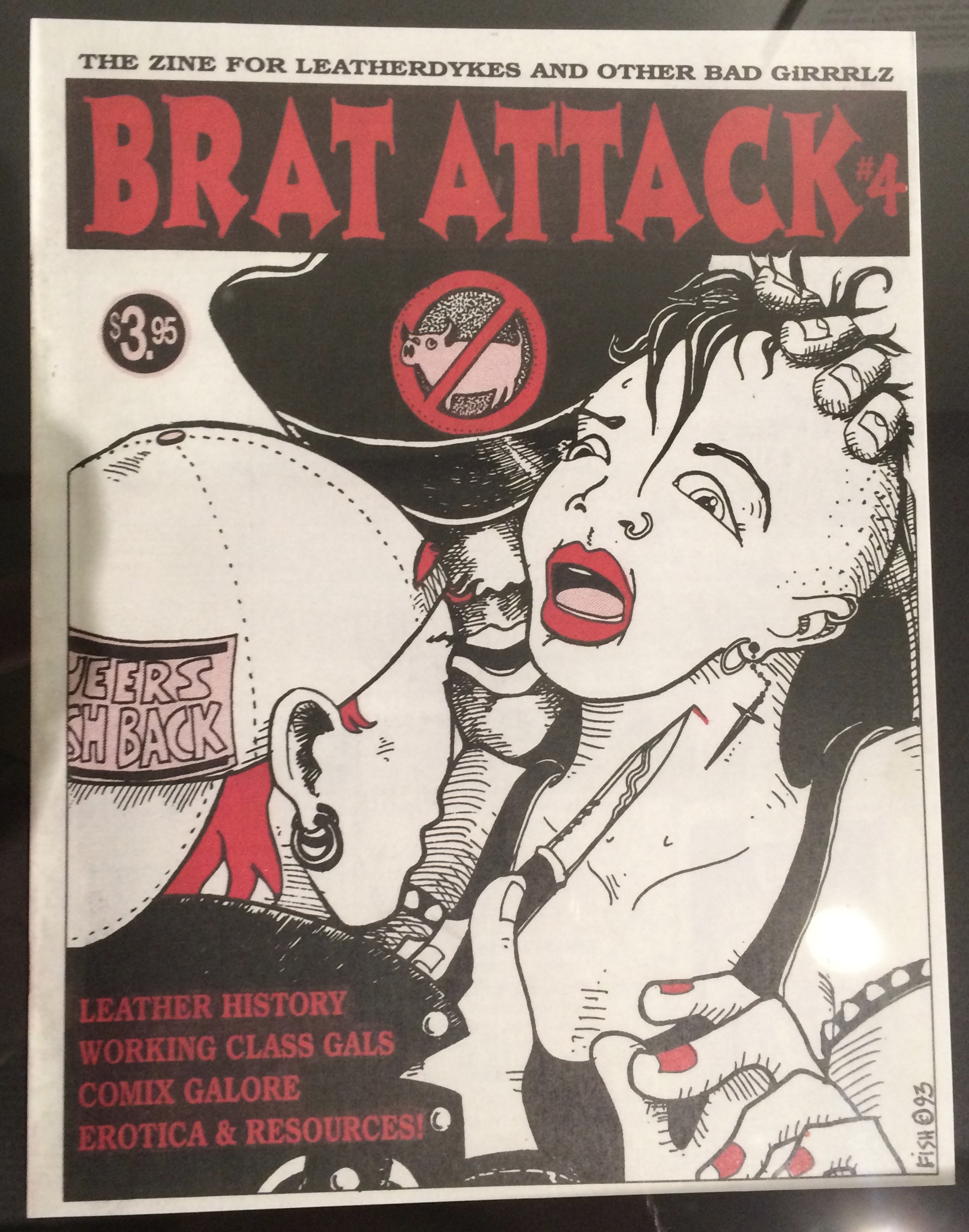 """Brat Attack is a short-lived """"leathergirl"""" zine that reflects the importance of pocket zines, mags, and posters to connect the leather community. These publications are often marked by violent imagery, hyperbolized figures, bright color contrasts, and a strong influence from the cartoon world."""