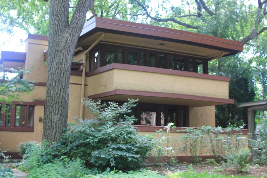 Oak Park, Laura Gale House with two terraces surrounded by foliage
