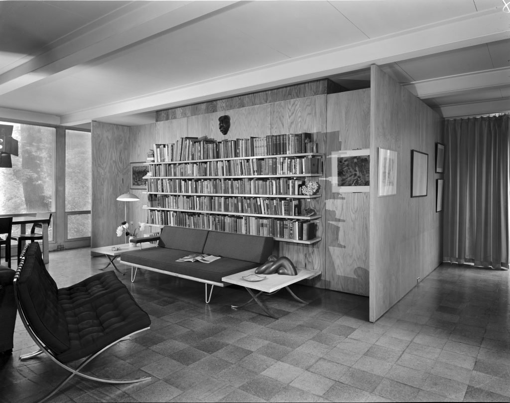 Black-and-white photo of study room in McCormick House with modernist chairs and bookcase
