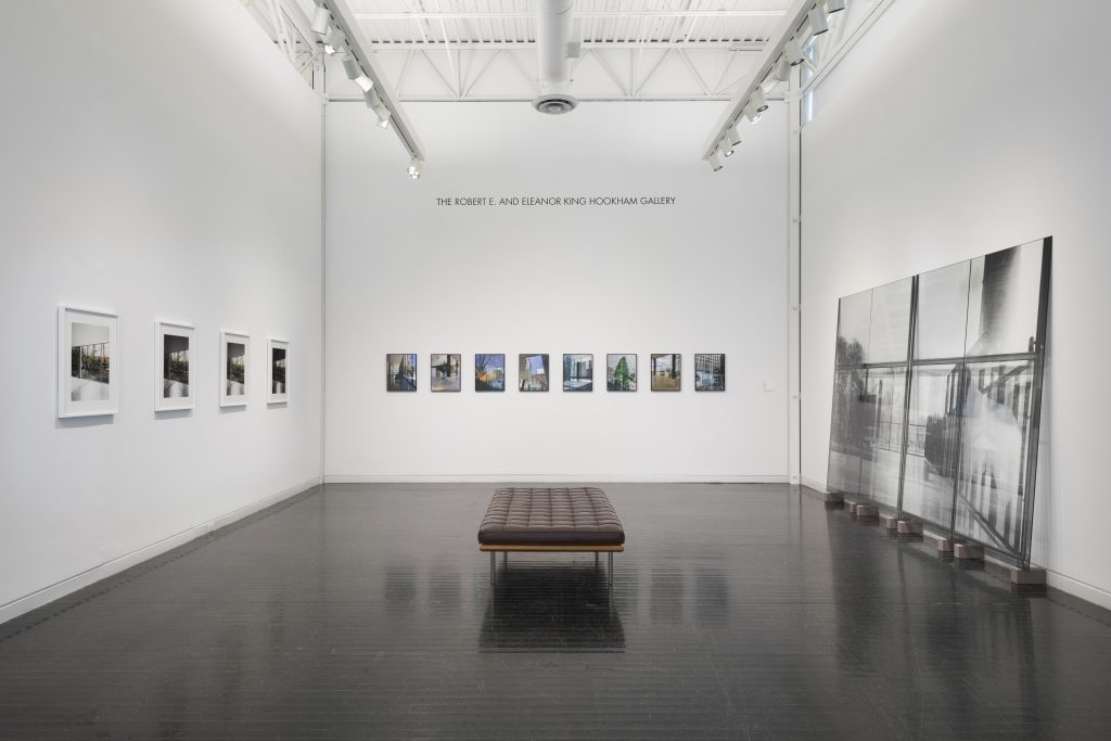 Gallery displaying McCormick House photos with bench in middle of room
