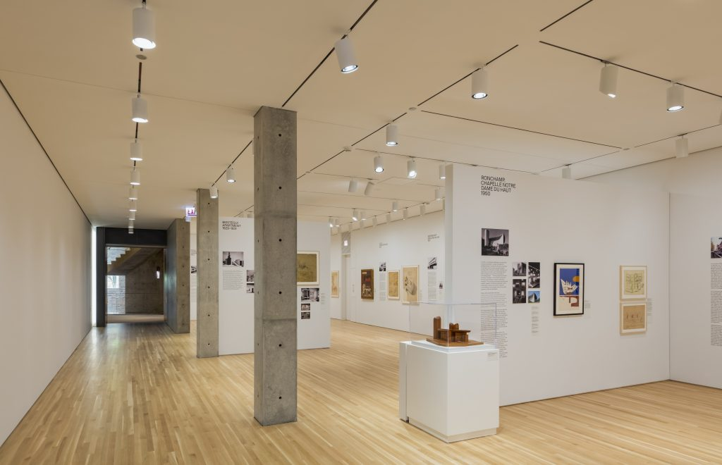 Exhibition gallery sowing two rooms of materials with exhibitions texts, blueprints and more