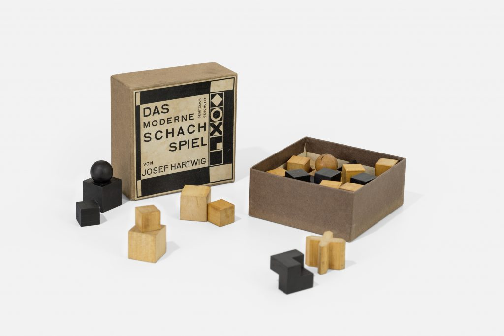 Board game with wooden pieces in various cube and 3D shapes