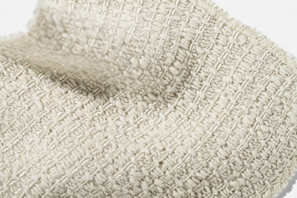 Close-up image of woven white blanket-like object