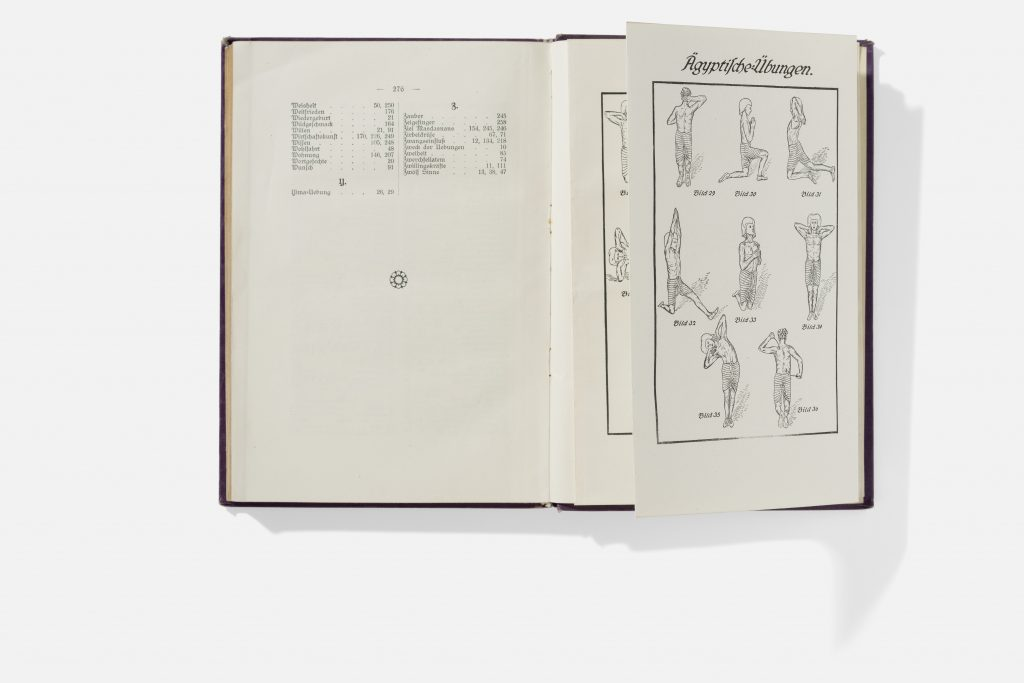 Open book with index on one page and illustrations of breathing exercises on the other