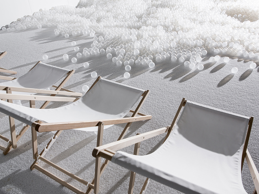 Lounge chairs open next to pile of white balls