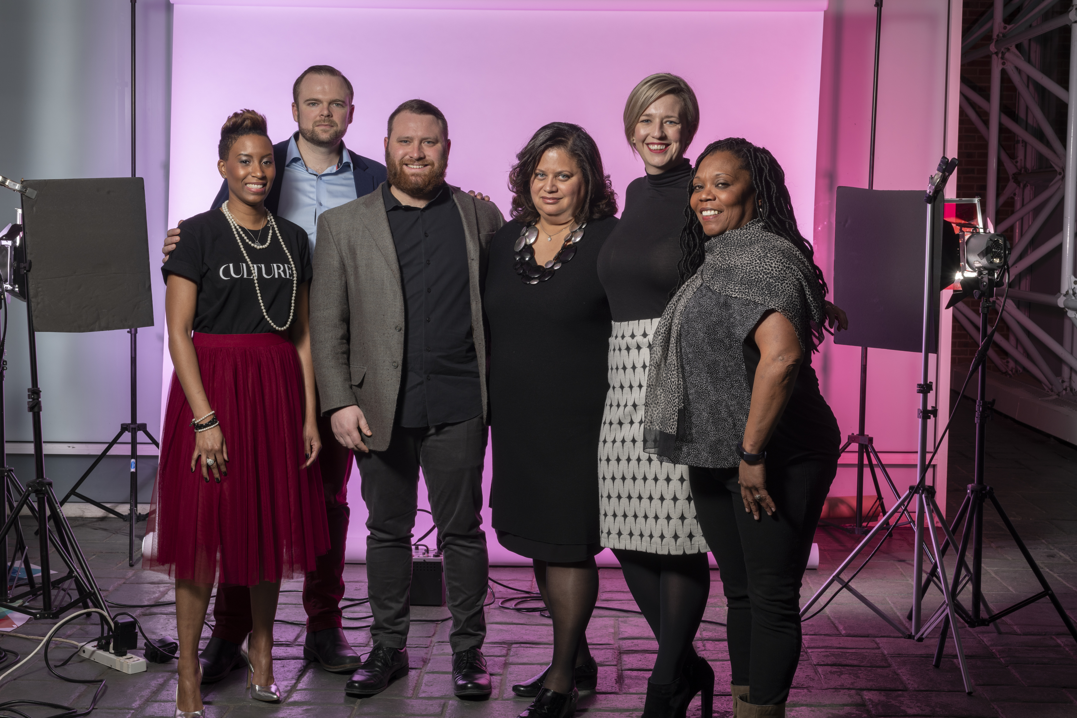 Navy Pier's Art, Culture and Engagement Team standing together at a photo studio