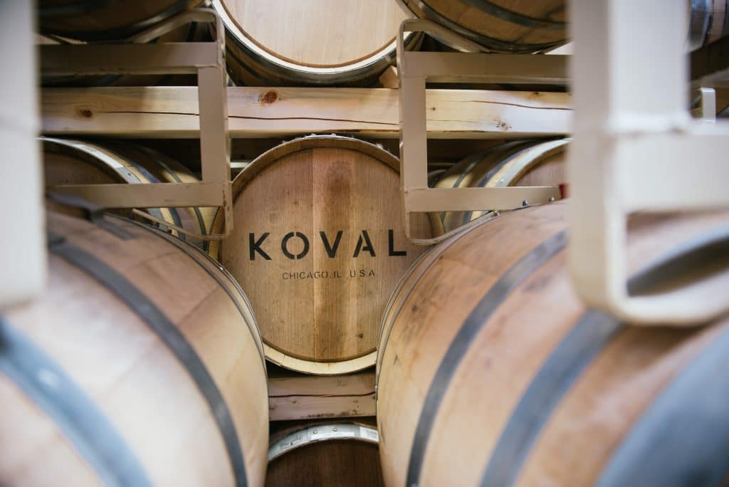 Barrels of KOVAL stacked onto one another in rows